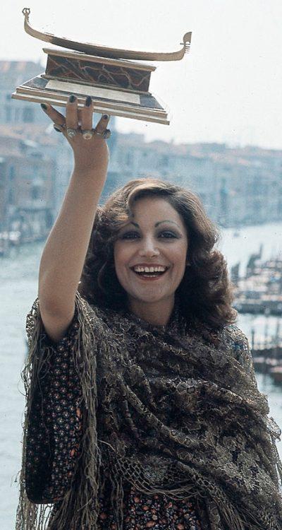 Italian singer Mia Martini (Domenica Berté) raising the Gondola d'Oro prize won at the Mostra Internazionale di Musica Leggera with the song Donna Sola. Venice, 1973